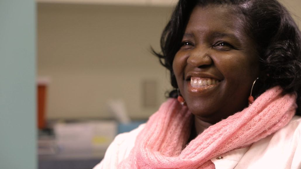 Nurse who specializes in peritoneal dialysis smiling